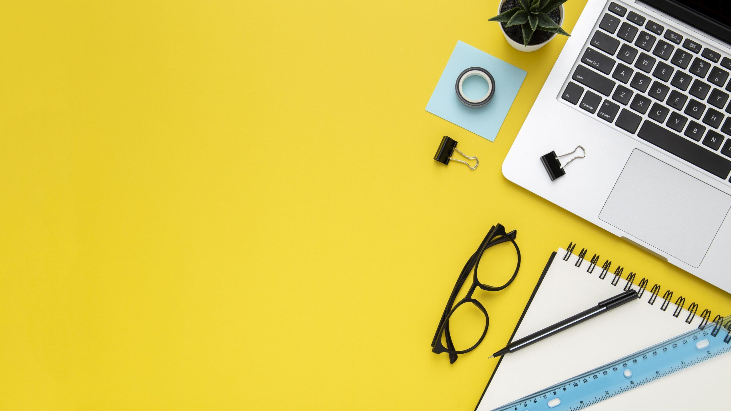 stationery arrangement yellow background with copy space scaled